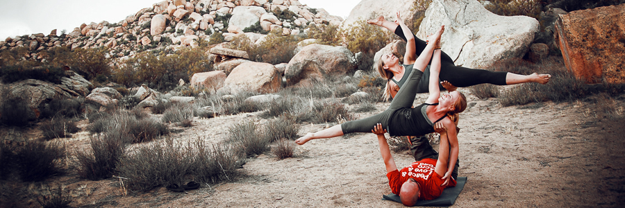Double Side-Vashistasana with Sariah Crull and Kristin Henry. Photo by Kabir Cardenas